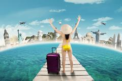 Stock Photo of Tourist with bikini take a trip to the worldwide monuments