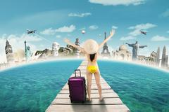 Woman in swimsuit take a journey to the world monuments Stock Photos