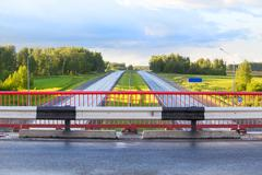 bridge over country highway - stock photo