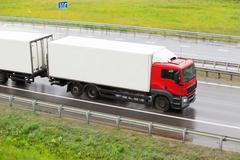 truck goes on wet highway to rain - stock photo