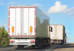 Trucks move on  mountain road Stock Photos