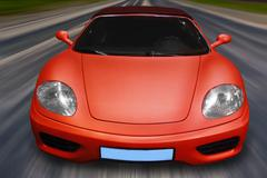 sports car rushes on road - stock photo