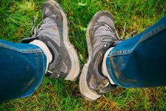 Legs in dirty shoes and jeans while hiking Stock Photos