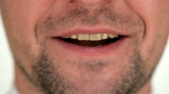 Part of the human unshaven face and smile - stock footage