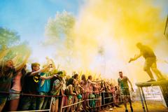 Stock Photo of Young people having fun together at Holi color festival in park