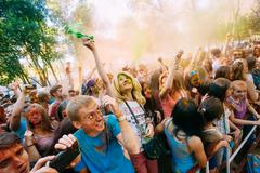 Young people having fun and dancing together at Holi color festival Stock Photos