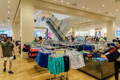 Stock Photo of Wide Selection Of Woman Clothes In Shopping Mall Store