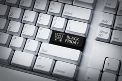 Black friday text and shopping cart on keyboard Stock Photos