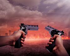 Man Aiming Two Gun To Burn City - stock photo