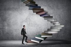 Business person step up flying book that look like stair - stock photo
