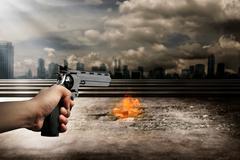 Man Aiming Gun To Burn City Stock Photos