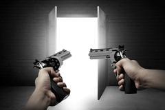 Man Hand Aiming Two Gun - stock photo