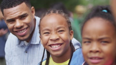 4K Portrait of attractive smiling African American family having fun in the park Stock Footage