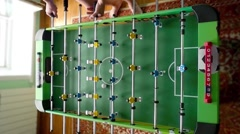 Young friends or students having fun together playing table football in Arkistovideo
