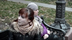 Mother and daughter are quarreling and cursing on the bench Stock Footage