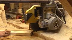 Carpentry.Carpenter sawing wood.Circular saw.Closeup Stock Footage