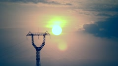 Time lapse of sunrise with transmission tower - stock footage