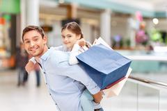 Father and daughter having fun in shopping mall Stock Photos