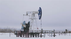 Oil and gas industry. Work of oil pump jack on a oil field.  Perfect for shots Stock Footage