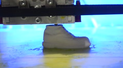 3D printer is a model in the form of shoe Stock Footage
