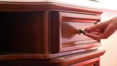 Women hand open old wooden  antique chest of drawers  with metal handles in Stock Footage