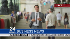 4K Male news reporter doing live piece to camera outdoors in the city Stock Footage