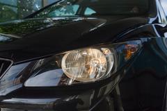 Spotlight On Black Car - stock photo