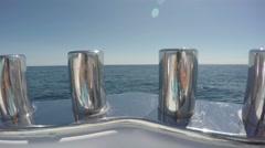 Detail of mooring bollard on luxury boat navigating fast Stock Footage