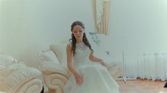 The bride shows white wedding shoes Stock Footage