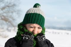 young woman is freezing on the walk - stock photo