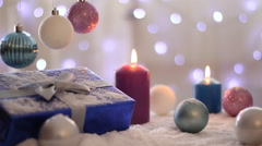 Christmas decoration with balls, gift and candles, Background lights - stock footage