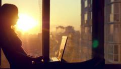 Beautiful young brunette business woman working on her laptop. Heaven sunset Stock Footage