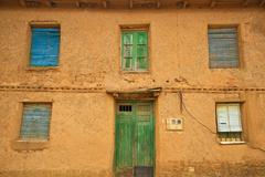 Facade of adobe house Stock Photos
