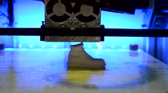 3D printer prints a figure in white plastic Stock Footage