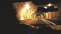 Girl driving a car in a Tunnel in the Highway Stock Footage