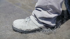 Footsteps on water - Close up SloMo - stock footage
