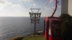 Red and yellow cable car at Rosh Hanikra grottoes, Mediterranean sea, Israel Stock Footage