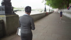 4K Woman in business dress in London being bothered by news reporter - stock footage