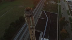 Aerial close up orbiting shot of Industrial Building in the fall sunset Stock Footage