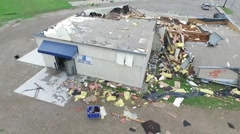 Ascending aerial view of tornado damage, destroyed building Stock Footage