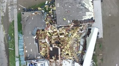 Spiraling aerial shot of tornado damage, wreckage aftermath Stock Footage