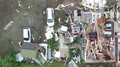 Aerial shot of tornado damage aftermath, looking straight down at wreckage Stock Footage