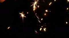Close up firework sparkler particles burning isolated in macro - stock footage
