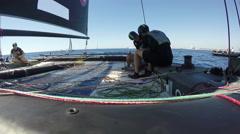 Sailors get ready on foiling catamaran GC32 before regatta - stock footage