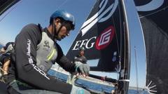 Sailors get ready on foiling catamaran GC32 before regatta Stock Footage
