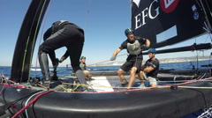 Sailors race on foiling catamaran GC32 during regatta Stock Footage