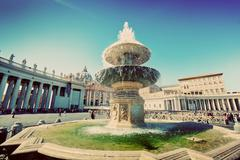 Fountain on St. Peters square in Vatican City. Vintage - stock photo