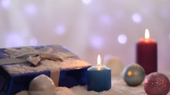Christmas decoration with balls, gifts and candles, Background blinking lights - stock footage
