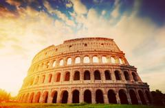 Colosseum in Rome, Italy. Amphitheatre in sunrise light. Vintage - stock photo