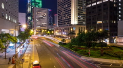 Car light trails timelapse and business district at night Hong Kong. Stock Footage